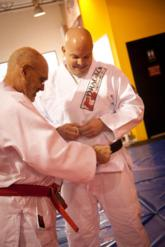 Prof. Rob Handley is promoted to 3rd degree black belt by Grand Master Flavio Behring
